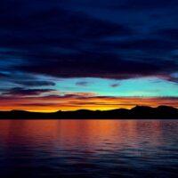 Solnedgang over Femunden av Henning Mella