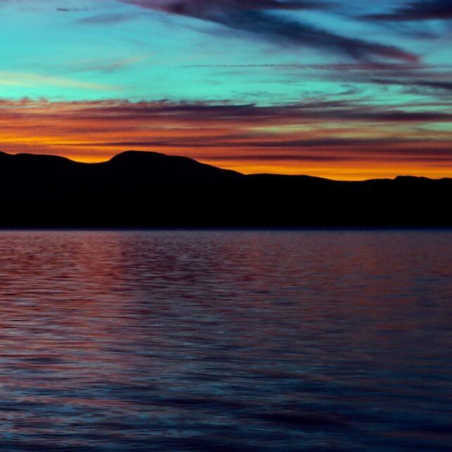 Solnedgang over Femunden, fotokunst veggbilde / plakat av Henning Mella