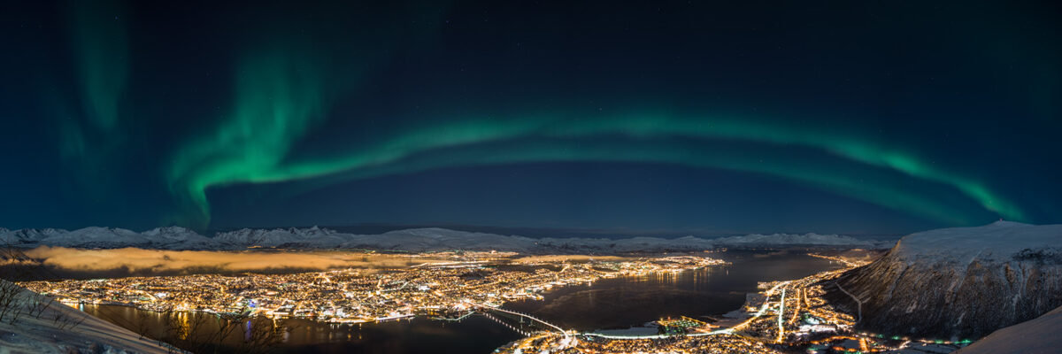 Nordlys over Tromsø, fotokunst veggbilde / plakat av Magne Tveiten