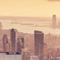 Solnedgang over Manhattan i oktober, fotokunst veggbilde / plakat av Peder Aaserud Eikeland